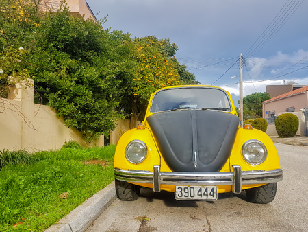 Athens, Greece 28 December 2017. Old retro sport yellow-black beatle car parked on the road. Editorial