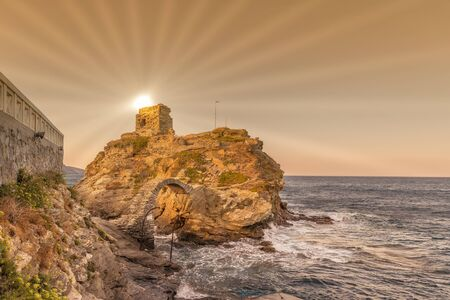 Chora bridge at Andros island in Greece against the sun.