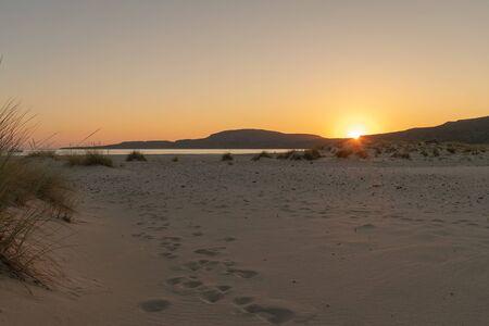 Beautiful sunset at Simos beach in Elafonisos. 스톡 콘텐츠