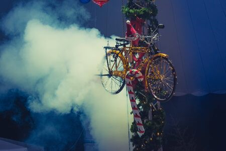 Christmas bicycle decoration with smoke as background. Close up look with bluish colors. Stok Fotoğraf