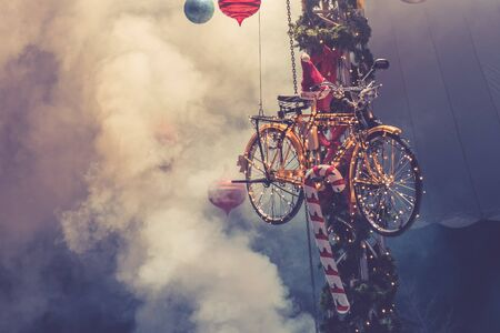 Christmas bicycle decoration with smoke as background. Close up look.