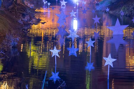 Decorated pond with stars at Christmas.