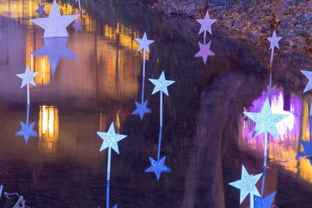 Decorated pond with stars at Christmas at night.