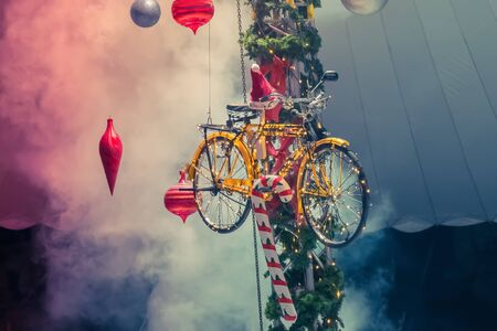 Christmas bicycle decoration with smoke as background.