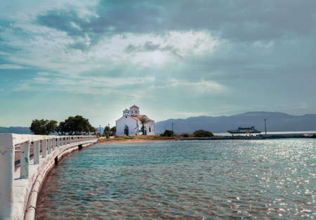 Saint Spyridon church at Elafonisos island. Landscape view against the sea.