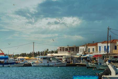 Elafonisos port in Greece aqgainst a dramatic sky. Famous touristic destination. 스톡 콘텐츠