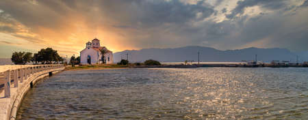 Panorama of Saint Spyridon church in Elafonisos in Greece against the sunset.