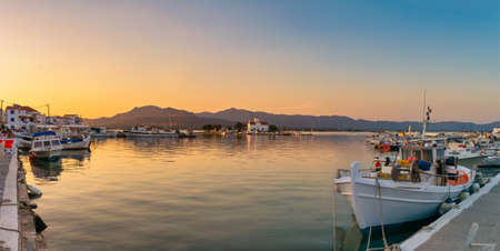Sunset at the port of Elafonisos in Greece. Magic view on summer.