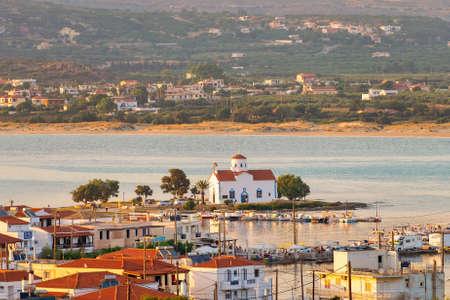 Landscape of Elafonisos island in Greece against Saint Spyridon Church.
