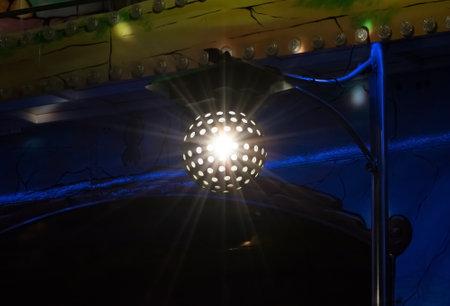 Disco lights at a funfair.