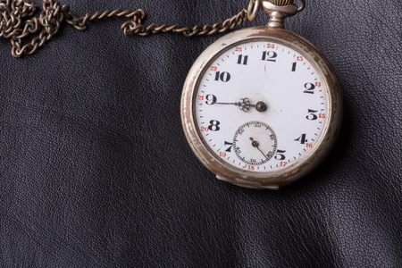 cronografo: old clock on a background of black leather