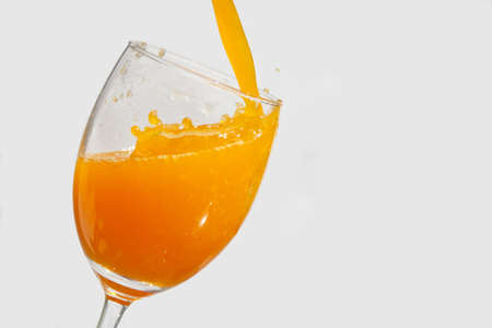 Pour into a glass of orange juice photo