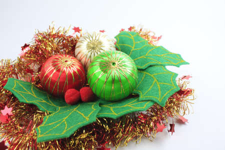 Leaf green Christmas ball on white background. Stock Photo - 11555104