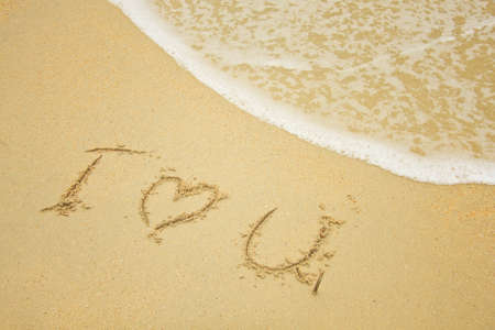 sand writing: inscription in the sand - i love you  Stock Photo