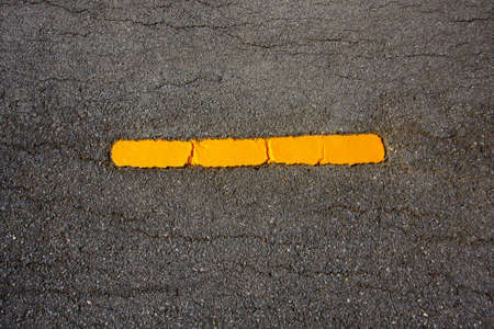 Yellow line on new asphalt detail  photo