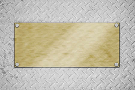 golden metal plate on concrete wall  photo