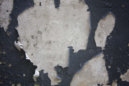 crackles: Old paint peeling from wall texture background
