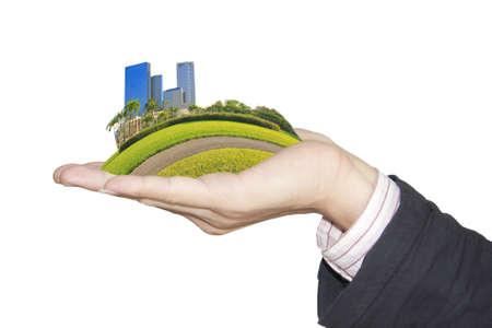 bright future: hand holding a city  Stock Photo