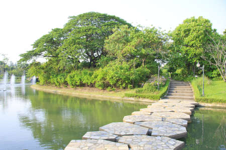 Stone Pathway in a Lush Green Park canal water photo
