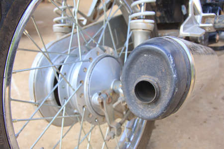 cuffed and dented motorcycle exhaust after low speed crash Stock Photo - 13526828