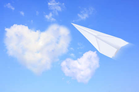 Aircraft paperblue sky with clouds, heart of love Stock Photo - 13526896
