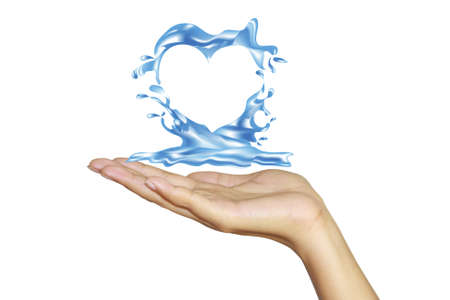 Heart from water splash with human hands isolated on white  photo