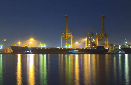 catchy: Cargo container port terminal, sunrise - catchy colors. Stock Photo