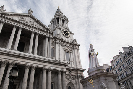 st pauls: St. Pauls Cathedral in London showing the Queen Anne statue and the Clock Tower