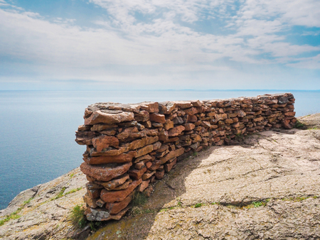 palisade: This is the edge of the cliff with rocks stacked as a barrier at Palisade Head. This is in the Lake Superior North Shore in Minnesota.