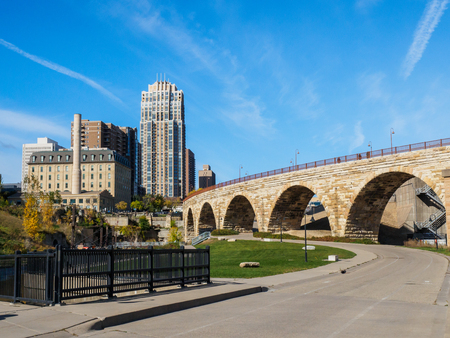 This is the Mill Ruins Park in Minneapolis, Minnesota. It features the Stone Arch Bridge and the ruins of flour mills.