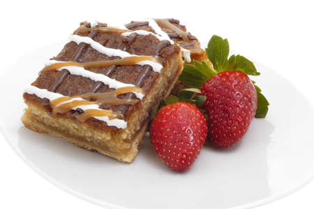 Delicious caramel crunch dessert square and strawberries.