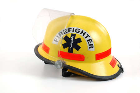 Yellow firefighters helmet on a white background. Imagens - 2421860