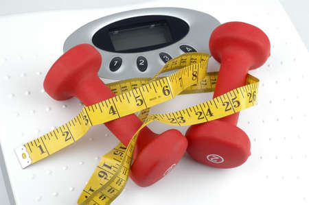 Weights on top of a weight scale. Imagens - 2415520