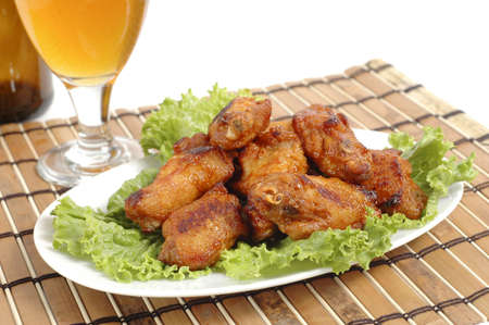 barbecued: Plate of delicious barbecued wings on bed of lettuce.