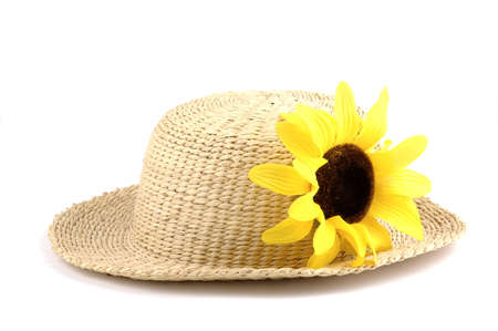 Straw hat with a bright yellow sunflower. Imagens - 2422606