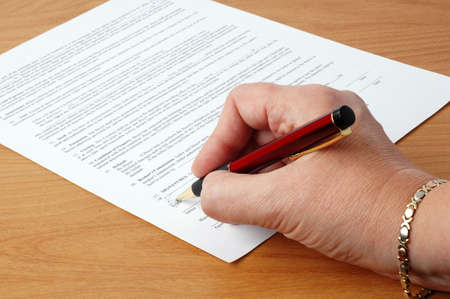 Signing a contract.