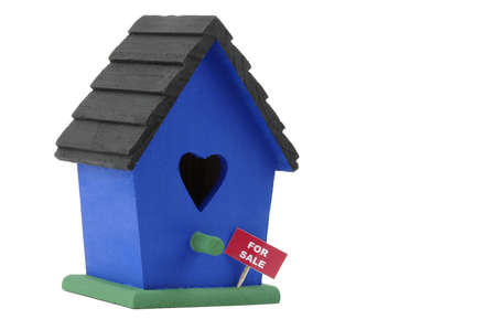 dwelling: Birdhouse with a for sale sign on a white background, Stock Photo