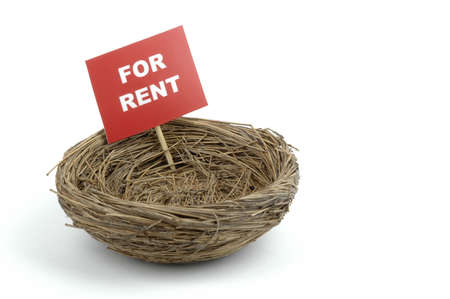 dwelling: Bird nest with a for rent sign.