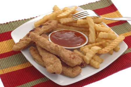 chicken fingers: Plate of chicken fingers served with french fries. Stock Photo