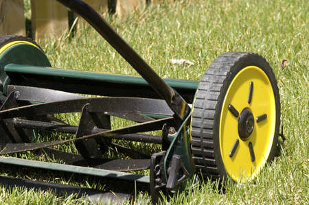 push: Reel type push mower that is environmentally friendly. Stock Photo