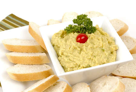 meatless: Delicious roasted garlic hummus dip with fresh bread.