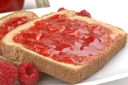 Toast with home made raspberry jam and raspberries.