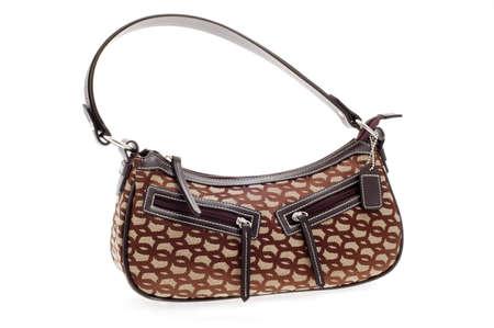 Brown womans designer handbag on a white background.