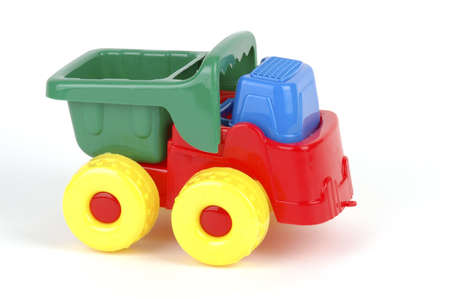 Colorful plastic toy truck on a white background. Imagens - 2438230