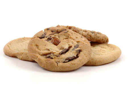 Assorted fresh baked cookies on a white background.