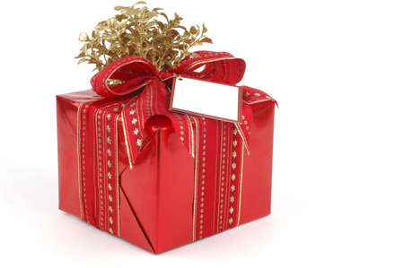 wrapped present: Beatifully wrapped present in red and gold.