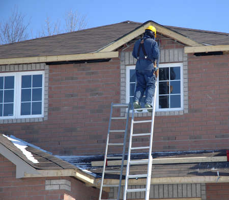 subdivisions: Tradesperson working on a new home.