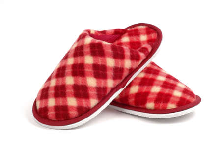 Cozy and warm tartan slippers on a white background.