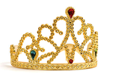 Gold tiara studded with jewels and diamonds. Imagens