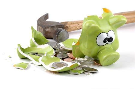 coinbank: Smashed coinbank derramando monedas canadienses a cabo. Foto de archivo